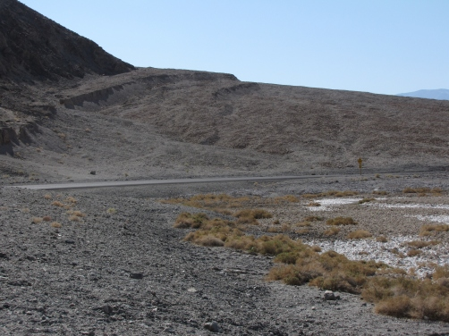 Elevated shelves provide evidence of faulting across this alluvial fan near Badwater Springs.
